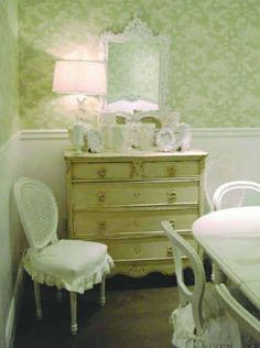 Shabby Chic Can Be Green, Too!  Shabby chic room themes can be reversed by using anitque white only as an accent and using larger areas of accent color, like this soft green wall. Notice how the antiqued dresser ties in both the white furniture and the green wall.