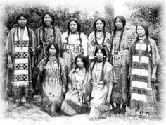 The 1903 Fort Shaw Indian School Girls Basketball team in native dress.