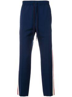 8560b2aabff8c Comprar Gucci pantalones joggers con motivo Web Pantalon Hombre