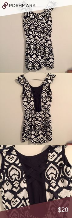 Charlotte Russe romper Excellent condition- worn once. Black and white design with ruffles on top and cutout with straps on back. Very comfortable. Charlotte Russe Other