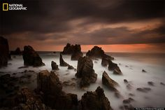 """Photo and caption by Henry Adam, National Geographic 2014 Photo Contest """"Pegadung Rock."""" Pegadung Rock known as rock screen (Batu Layar) and Shark Teeth (Gigi Hiu) because the shape of the cluster of rocks resembling shark teeth. Photo Location: Lampung, Indonesia"""