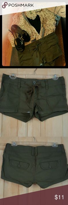 Empire Military Green Shorts Olive short shorts, 2 inch inseam. Button back pockets. Double button and zipper closure with a drawstring. These are in excellent condition. New, these had a worn casual look. That's the style. They are incredibly comfy. I hate to admit this, but I don't think I will ever fit into them again :-( but they have a lot of life left for someone else! I liked to pair them with feminine florals and ruffles to counter the olive color. Size 5. Shorts