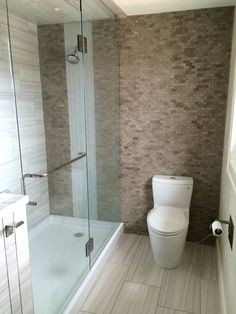 "Glass shower with a solid acrylic base pan.  Split-face slate accent wall with glass tile ""waterfall"" effect"