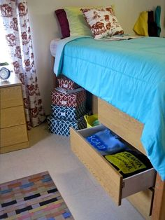 A lot of people put their dressers under their lofted beds to save space. In some halls, desks will fit also.