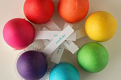 Dyed eggshells, filled with mini chocolates/sweets with a papercup base to seal and labelled: Crack me