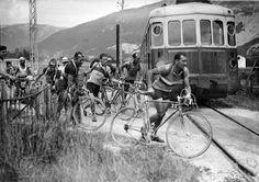 Roger Lapébie, right, crossing train tracks on his way to winning the 1937 Tour. Lapébie was the first rider to use a modern derailleur, allowing him to shift gears without having to dismount and flip his wheel.