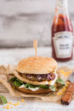 cajun chicken burger with grilled pineapple and onions