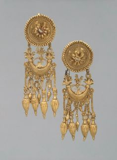 ~Pair of Earrings with a Disc and a Boat-Shaped Pendant. Date: Third quarter of the 4th century BC Place of finding: Krasnodar Territory, Taman Peninsula, near the Cossack Village of Vyshesteblievskaya Archaeological site: Great Bliznitsa Barrow Material: gold