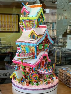 Amazing gingerbread house display made by Sonny Robertson of Freed's bakery in Las Vegas. I love the colors so much! Amazing gingerbread house display made by Sonny Robertson of Freed's bakery in Las Vegas. I love the colors so much! Cool Gingerbread Houses, Gingerbread House Designs, Gingerbread House Parties, Christmas Gingerbread House, Christmas Candy, Christmas Desserts, Christmas Treats, Christmas Baking, Xmas