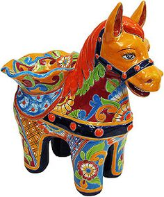 These adorable Talavera pony planters feature wonderfully intricate floral patterns that will look great with your plants, indoors or out!  The ceramic of these Talavera planters is hand-painted in Dolores Hidalgo, Mexico, and embodies all the classic charm of Mexican Talavera.  All Talavera planters also feature a convenient drain hole.  Let the bright colors and your plants breathe life back into your home decor!