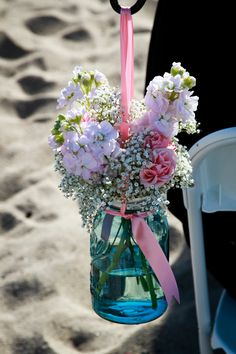 Stocks, baby's breath and pink carnations are all affordable flowers for the centrepieces