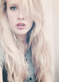 Blonde curly natural long hair. Blue eyes. Hashtag.
