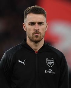 Aaron Ramsey of Arsenal looks on before the UEFA Europa League Round of 16 Second Leg match between Arsenal and Stade Rennais at Emirates Stadium on March 2019 in London, England. Get premium, high resolution news photos at Getty Images Arsenal Players, Arsenal Fc, Nike Football, Football Players, Long Wavy Haircuts, Grey Hair Men, David Price, Beautiful Men Faces, Vintage Man