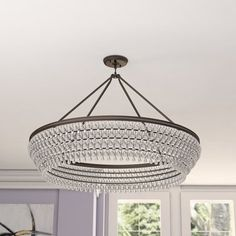 Set eye-catching style overhead with this Crystal Chandelier. Framed by round steel with a sleek polished finish, this design is dripping with elegant clear glass accents. Let it sit above a neutr Round Chandelier, Sputnik Chandelier, Chandelier Shades, Chandelier Lighting, Dining Lighting, Living Room Lighting, Elegant Chandeliers, Bowl, Living Room Interior