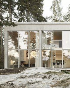 Lar de concreto e vidro