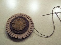 Penny Rug Tutorial - join into regular rugs or even mug rugs. Great project for long car trips!