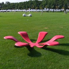 The flower bench  With this lovely, imaginative bench by Naho designs you get to sit on a flower petal! It looks great on a lawn, it is funny, and most of all it is pink – a very rarecolorin street furniture indeed! It is also quite versatile – the users can sit on the petals or inside the flower. It certainly looks comfortable!