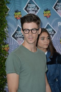 Grant Gustin is amazing.....BUT THAN THEIRS JUST ROWAN BLANCHARD IN THE BACKGROUND AND I LOVE HER SOMEBODY HELP ME PLZ...