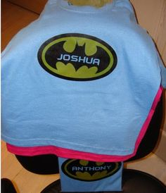 Batman Birthday party favor.. tshirt for each child.. I think I would just make a black cape and put their name on the back.