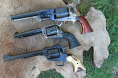 Single Action Evolution. - Revolver -From Top: Replica of 1849 vintage. .44 Colt Revolving Holster Pistol (Dragoon); Colt Single Action Army Model 1873; Ruger (New Model) Super Blackhawk- Mid and late 20th Century.