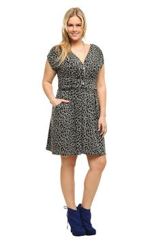 0b09b68475a An exotic cheetah print wildly patterns this knit surplice dress. Softly  ruched