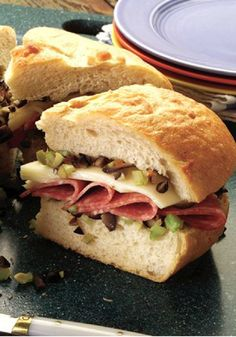 """New Orleans Muffuletta – Being inspired by """"The Big Easy"""" is fitting. This dish is big enough to share with eight friends and easy to make too—the hardest part is waiting for it to cool in the refrigerator. Now that's something to celebrate!"""