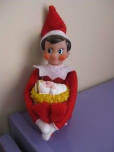 25 Elf on the Shelf QUICK & EASY Ideas that take Under 5 mins! I love these ideas. Here he is with baby Jesus from the Fisher Price Nativity set. Keep seeing Elf on the Shelf things, so I guess I need to read up on what it's all about.
