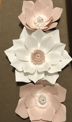 White, blush and pink paper flowers. I used a small flashlight to build the center on. Perfect size for wrapping, turning and glueing.