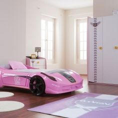 Extraordinary Bedroom for Little Girl with Luxurious Pink Race Car Shaped Bed Frame as Well as Cool Wardrobe and Purple Area Rug