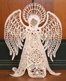 """Free-standing machine-embroidery lace angel design. Approximately 8.5"""" tall, requires a minimum 5x7"""" hoop for sewing but really designed for larger hoops (200x300mm hoop for skirt and 200x200 hoop for head and wings)."""