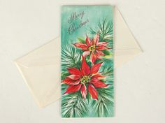 Sparkly gold glitter highlights the red poinsettias on this vintage aqua Christmas holiday card. An unused card from: Carrington  Inside verse