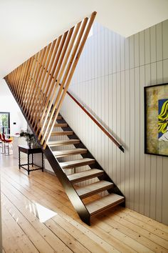 """Strong contemporary gestures – timber battens, rugs and graphic fabrics and wallpaper – create drama, yet Michelle was careful to maintain a link between the different areas of the home. """"Donald used slatted timbers extensively outside, so we used slatted timbers in various forms inside,"""" she says."""