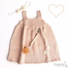 Baby girl outfit essentials ☺️. Baby headband, knitted dress and silicone pacifier holder #babygirlsdress #FairTrade #OrganicBaby #siliconepacifierclip Like on Instagram @LiapelaModernBaby