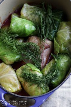 Romanian Stuffed Cabbage Leaves (Sarmale) added wine, garlic, cumin, 5 spice, to sauce apple to top of rolls Cabbage And Bacon, Cabbage Leaves, Green Cabbage, Cabbage Rolls, Cabbage Recipes, Romanian Food, Romanian Recipes, Romanian Gypsy, Turkish Recipes