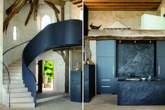 smooth steel stairway balustrade /  black volcanic stone kitchen