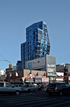 The Blue Tower. This seventeen-storey tower, located in the Lower East Side (close to the Williamsburg Bridge), contains thirty-two apartments. (Architect: Bernard Tschumi). I'd love to see the setting - its definitely a low rise neighbourhood.