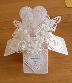 A traditional Ivory Wedding Themed box A very traditional look in Ivory. Lacy flowers and butterflies, with a subtle shimmer, combi...