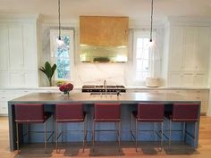 Chic family kitchen in this nearly complete custom house by Banks Development featuring an 11 ft waterfall concrete island, antique leather stools, lacquered brass hood & calacatta gold perimeter counters & wall, Lacanche range. Glass light fixtures by FritzFryer.Co.UK. @allybanks1 @msumner08 #banksdevelopment #banksdevco