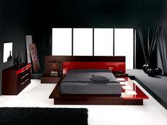 Door zwart met rood te combineren ontwikkel je een stoere slaapkamer.