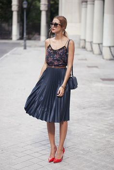 Go for a black floral tank and a black pleated leather midi skirt for a refined yet off-duty ensemble. Red leather pumps will instantly smarten up even the laziest of looks. Shop this look on Lookastic: https://lookastic.com/women/looks/tank-midi-skirt-pumps/18079 — Dark Brown Leopard Sunglasses — Black Floral Tank — Black Leather Crossbody Bag — Gold Bracelet — Black Pleated Leather Midi Skirt — Red Leather Pumps