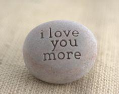 i love you more - engraved beach pebble by sjEngraving. $16.00, via Etsy.