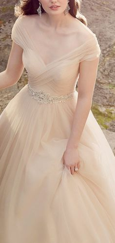 Glamorous champagne colored off-the-shoulder tulle ballgown wedding dress; Featured Dress: Essense of Australia,.... Pribly wouldnt wear it but gosh its pretty.