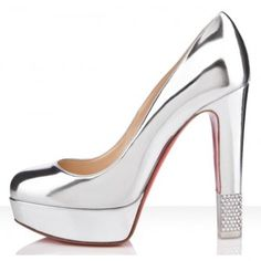 "Christian Louboutin Filter Pumps      Monsieur Louboutin has made his own trompe l'oeil with the ""Filter Pump."" Her hand placed crystal detail gives the illusion that your sky high heel ends in mid-air. What a beautiful way to deceive the eye.  COLOR:Silver"