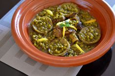 Classic Moroccan recipe for beef or lamb tagine with peas and artichoke bottoms. A seasonal favorite seasoned with ginger, saffron, and turmeric.