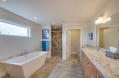 Master bath with stand alone tub and curbless shower. Designed and built by Quail Homes of Vancouver Washington.