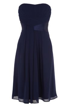A classic bandeau dress with a truly beautiful feel. The Avra Short dress features a sweetheart neckline and ruched detailing at the bust twisting in the centre of the dress and draping down the skirt. The bodice features enclosed boning for a seamless secure fit and has a concealed back zip fastening. The dress is fully lined for effortless movement and is 81cm/ 32 inches in length from neck to hem. Height of model shown: 5ft 9inches/175cm. Model wears: UK size 10.