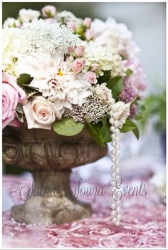Daily Pretty:  Stone urn filled with Ecuadorian roses, baby spray roses, dahlia, lemon leaf, Queen Anne's lace, baby's breath, hydrangea and dripping pearls. Image by Damion Hamilton.