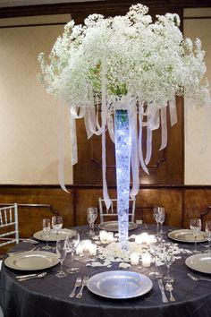 Image detail for -Engagement-Gala-baby-breath-centerpiece.jpg  Could be draped with pearls as well.