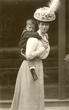 Princess Mary, Duchess of York with the future King George.  I love this picture!   (Queen Elizabeth II 's father)