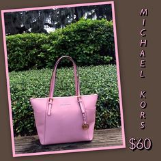 f5fa37750d3d Incorporate color into your wardrobe with a colorful handbag!! This  #gorgeous light pink Michael Kors tote is only $60 at Clothes Mentor Palm  Harbor.